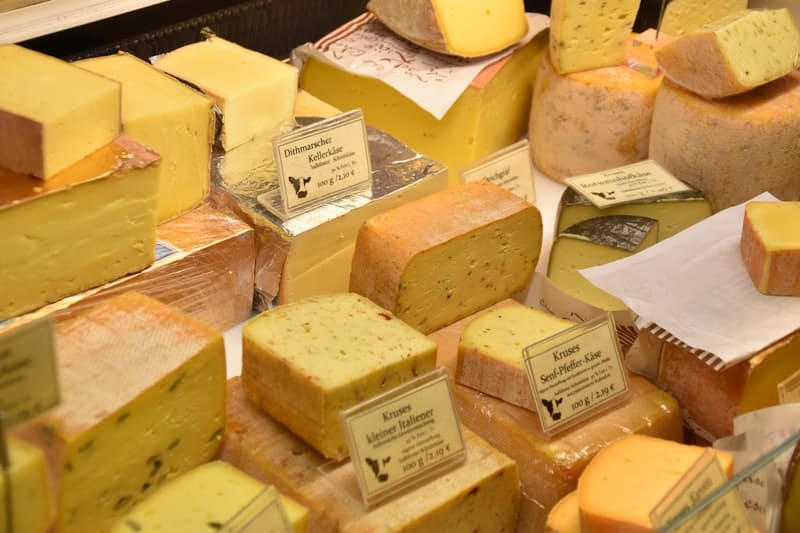 A box filled with lots of cheese